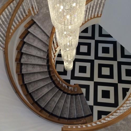 Luxury hanging chandelier over stairway