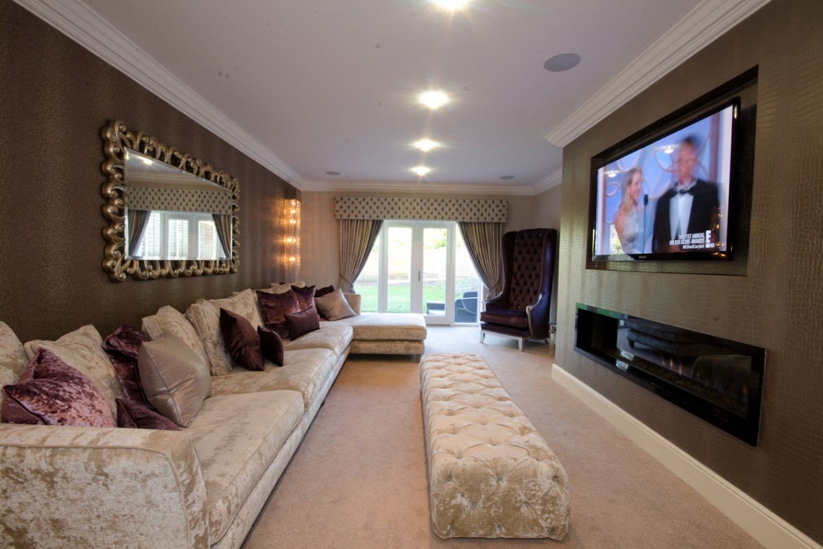 Sitting room design with bespoke 4 piece sofa, arm chairs, tablounge and designer wallpaper
