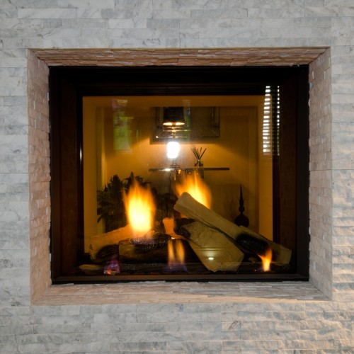 tunnel gas fire with marble tile surrounding design