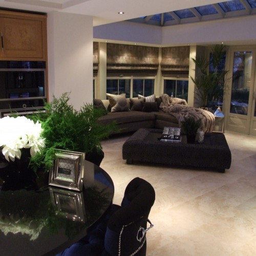 Orangery design with bespoke soft furnishings, roller blinds and upholstered sofa.