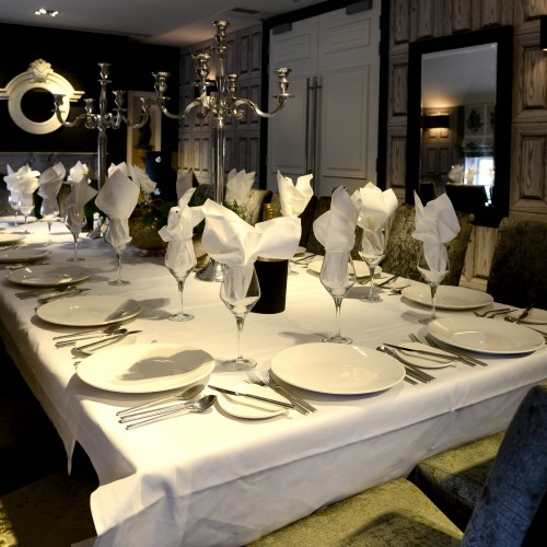 fine dining function room with upholstered seating and accessories
