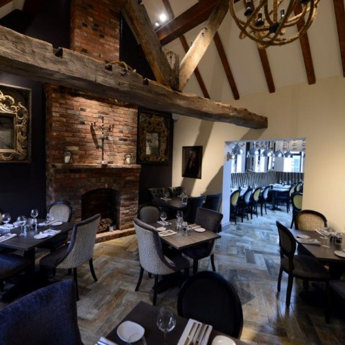Gastro interiors with Fireplace design in quiet dining area of restaurant