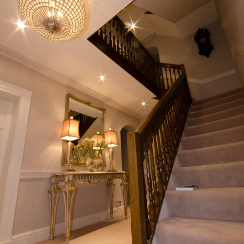 Hall and stairs interior design with Console Table and accessories