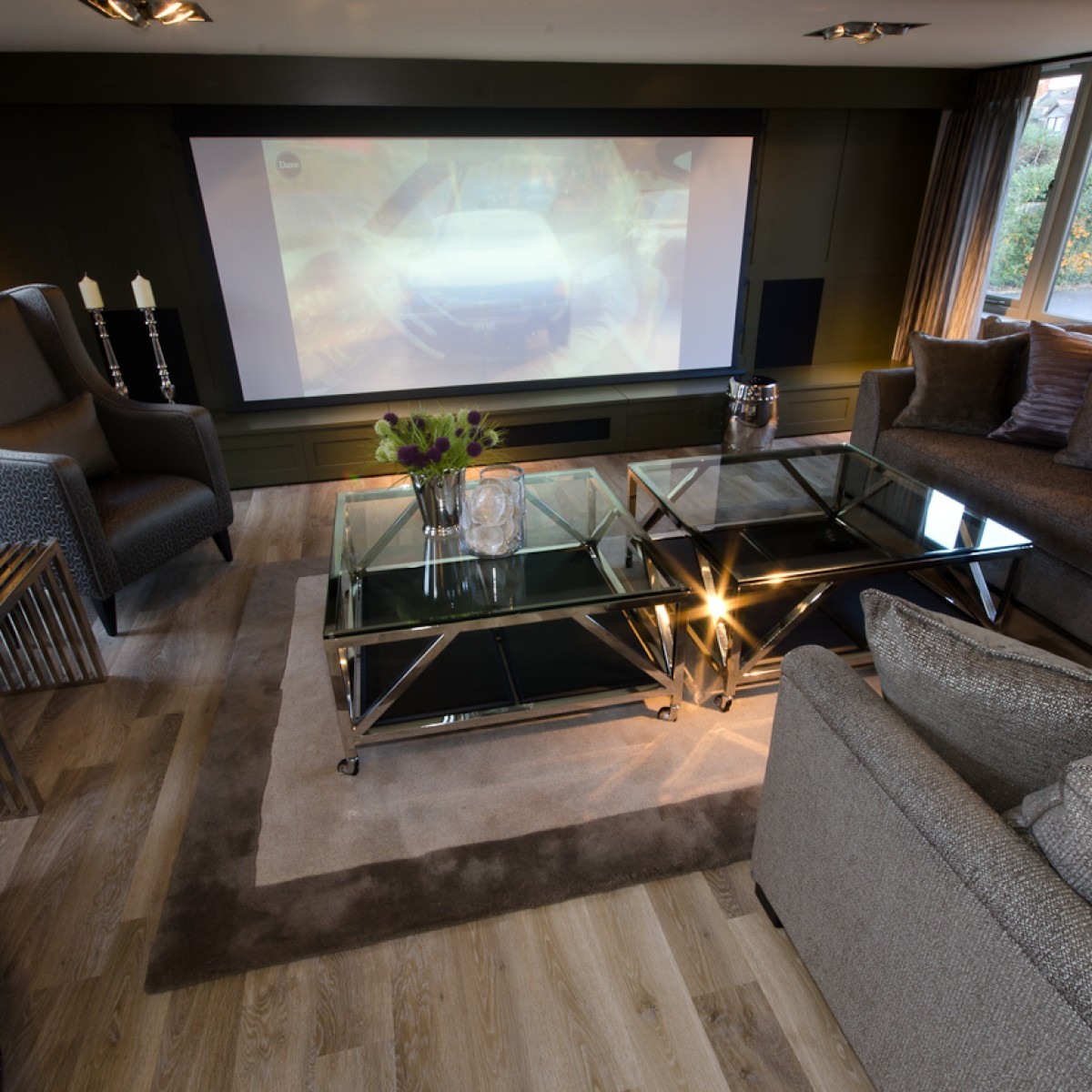 Contemporary living room with cinema screen