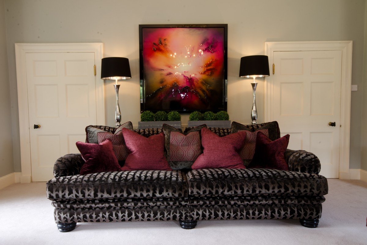 Mink velvet sofa with deep red furnishings from traditional home design