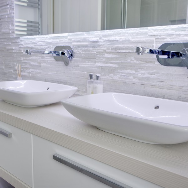 Double sink unit with soft tile tones for a modern bathroom