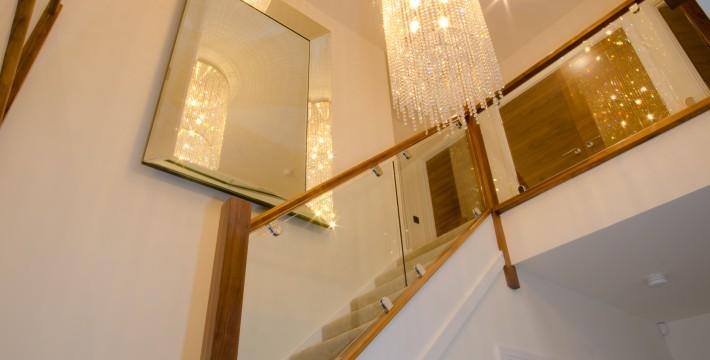 free falling chandelier stairway interior